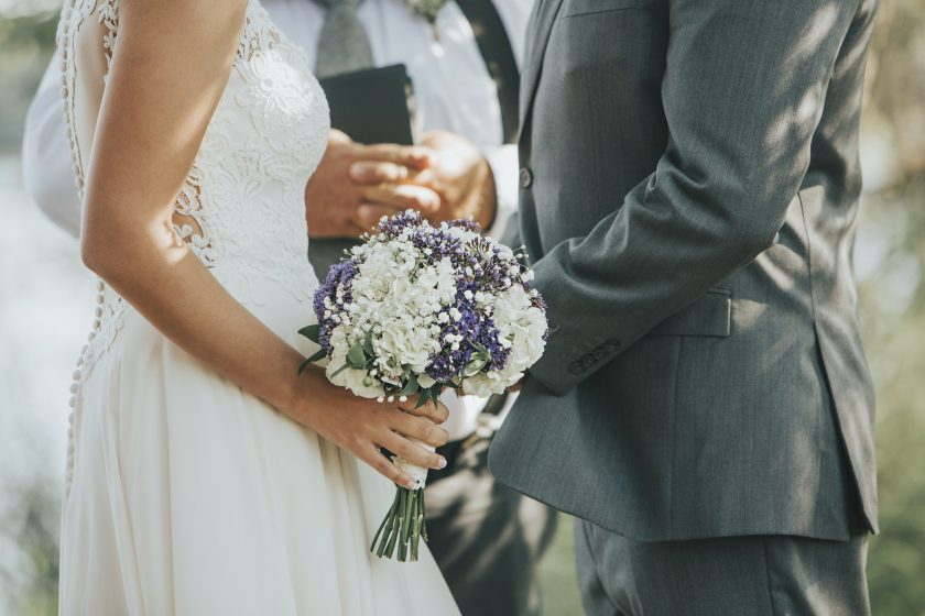 Bride and Groom Saying Vows during Wedding Ceremony Outdoors