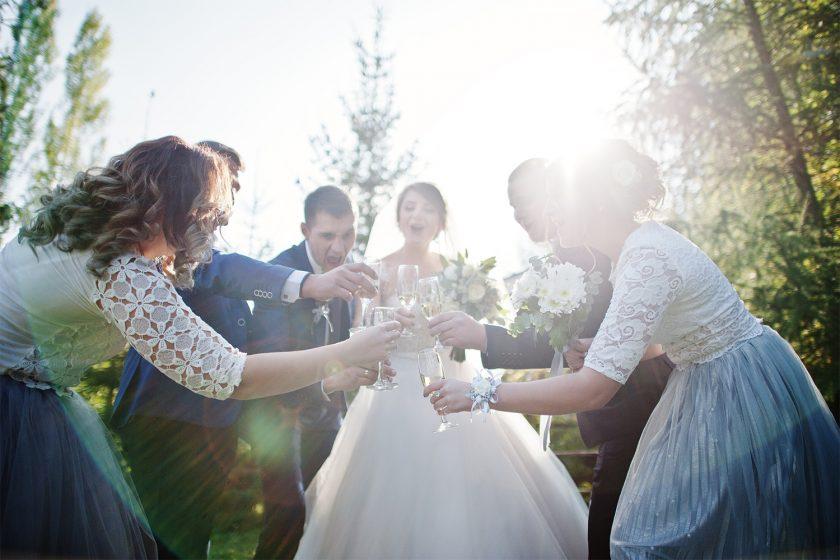 Wedding couple and groomsmen with bridesmaids